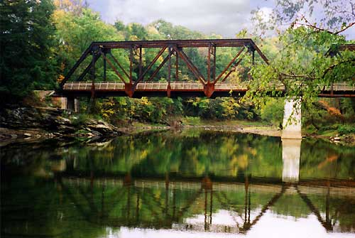 Find the old railroad bridge and swimming hole along the river.
